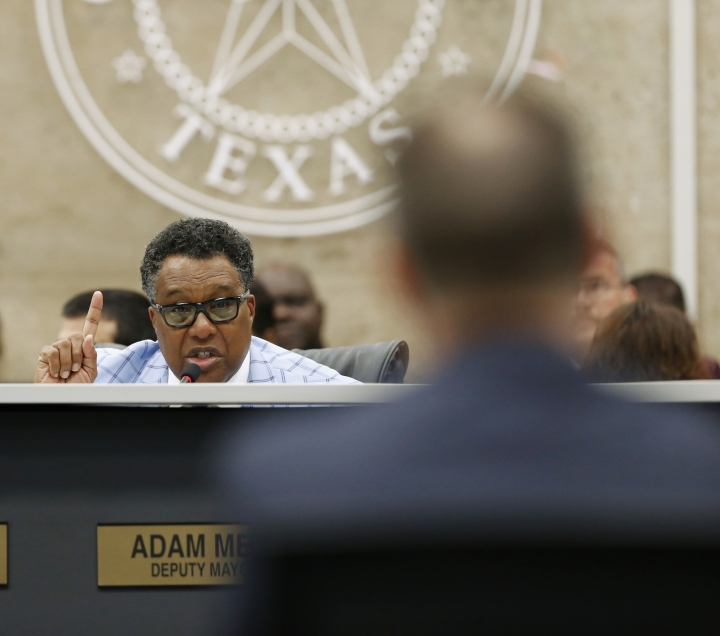In this April 18, 2018 photo, Dwaine Caraway, District 4 representative, asks questions at Dallas City Hall in Dallas. Federal prosecutors said Caraway accepted more than $450,000 in kickbacks and bribes, in part through gambling money, trips to Las Vegas and other cities, and a phony consulting agreement. Court documents filed Thursday, Aug. 9, show Caraway pleaded guilty to wire fraud and tax evasion. (Nathan Hunsinger/The Dallas Morning News via AP)