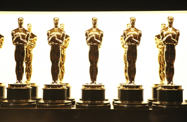 """FILE - In this Feb. 26, 2017 file photo, Oscar statuettes appear backstage at the Oscars in Los Angeles. When the Academy of Motion Pictures Arts & Sciences announced changes to next year's Oscars broadcast, including the controversial creation of a """"popular film"""" category, it prompted a host of questions about what this means for the world's biggest awards show. (Photo by Matt Sayles/Invision/AP, File)"""