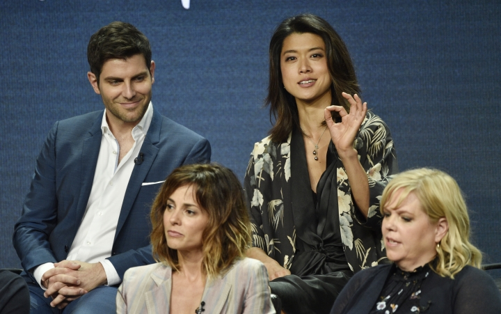 "Grace Park, top right, answers a question as fellow cast members in the Disney ABC television series ""A Million Little Things,"" David Giuntoli, top left, and Stephanie Szostak, bottom left, and executive producer Dana Honor look on during the 2018 Television Critics Association Summer Press Tour, Tuesday, Aug. 7, 2018, in Beverly Hills, Calif. (Photo by Chris Pizzello/Invision/AP)"