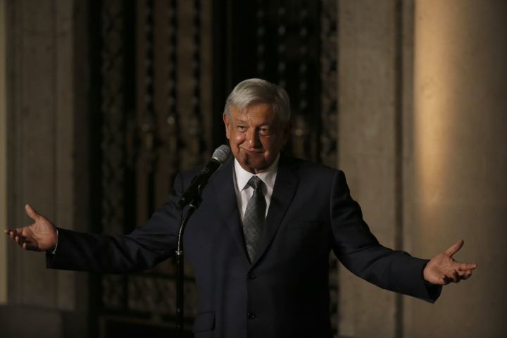 Mexico's President-elect Andres Manuel Lopez Obrador speaks to reporters after meeting with Mexico's President Enrique Pena Nieto at the National Palace in Mexico City, Thursday, Aug. 9, 2018. The leftist candidate, who won in his third try for the presidency with a resounding 53 percent of the vote, will take office on Dec. 1. (AP Photo/Marco Ugarte)