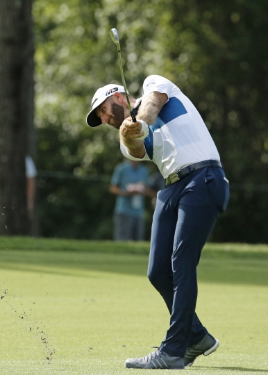 Dustin Johnson hits from the 15th fairway during the first round of the PGA Championship golf tournament at Bellerive Country Club, Thursday, Aug. 9, 2018, in St. Louis. (AP Photo/Charlie Riedel)