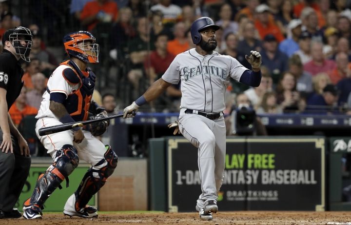 Seattle Mariners' Denard Span watches his two-run home run in front of Houston Astros catcher Martin Maldonado during the second inning of a baseball game Thursday, Aug. 9, 2018, in Houston. (AP Photo/David J. Phillip)