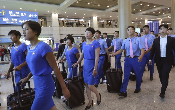 FILE - In this July 29, 2018, file photo, a North Korean delegation arrives for joint Asian Games training with South Koreans at Incheon International Airpot in Incheon, South Korea. The war-separated rivals will take their reconciliation steps to the Asian Games in Jakarta and Palembang, Indonesia, where they will jointly march in the opening ceremony and field combined teams in basketball, rowing and canoeing. (AP Photo/Ahn Young-joon, File)