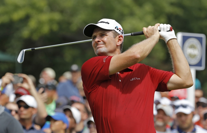 Justin Rose, of England, watches his tee shot on the sixth hole during the first round of the PGA Championship golf tournament at Bellerive Country Club, Thursday, Aug. 9, 2018, in St. Louis. (AP Photo/Charlie Riedel)
