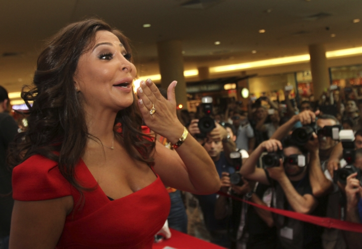In this July 13, 2012, photo, Lebanese diva Elissa, whose real name is Elissar Khoury, one of the best known and highest-selling female artists in the Arab world, kisses her fans, in Beirut, Lebanon. Elissa broke taboos this week with a video clip announcing she had breast cancer. It was an unusual way to reveal a struggle against cancer, particularly in a part of the world where the illness is still largely considered a private matter and a taboo, and the response was overwhelming. (AP Photo)