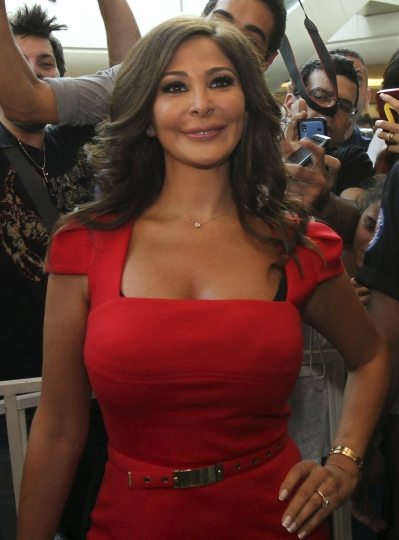 In this July 13, 2012, photo, Lebanese diva Elissa, whose real name is Elissar Khoury, one of the best known and highest-selling female artists in the Arab world, poses for photographers, in Beirut, Lebanon. Elissa broke taboos this week with a video clip announcing she had breast cancer. It was an unusual way to reveal a struggle against cancer, particularly in a part of the world where the illness is still largely considered a private matter and a taboo, and the response was overwhelming. (AP Photo)