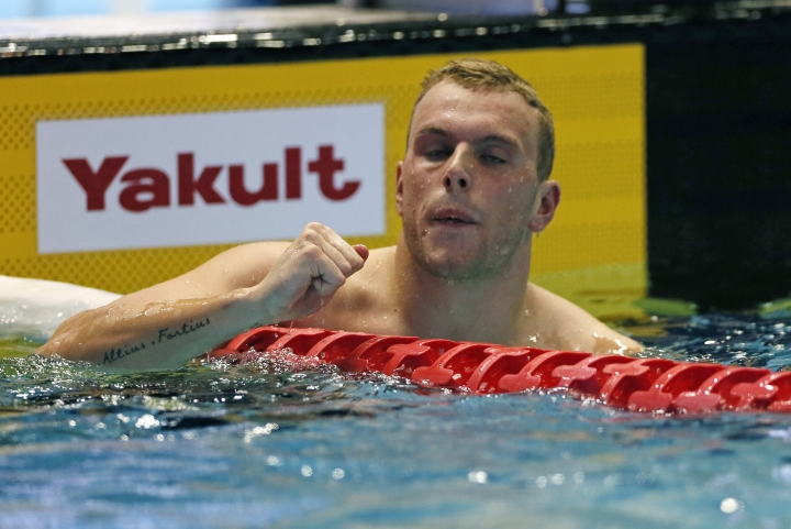 Australia's Kyle Chalmers reacts after winning the men's 100m freestyle final during the Pan Pacific swimming championships in Tokyo, Friday, Aug. 10, 2018. (AP Photo/Koji Sasahara)