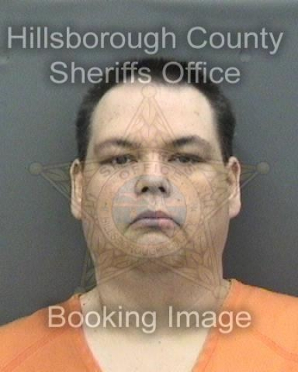 "This booking photo provided by Hillsborough County Sheriff's office shows Brian Sebring. A political argument on Facebook led Sebring driving to the home of a stranger he'd been arguing with and shooting him. Sebring faces felony charges of aggravated battery and carrying a concealed gun. Sebring tells the Tampa Bay Times he ""just snapped and let primal rage take over"" on Monday, Aug. 6 2018. (Hillsborough County Sheriff's office via AP)"