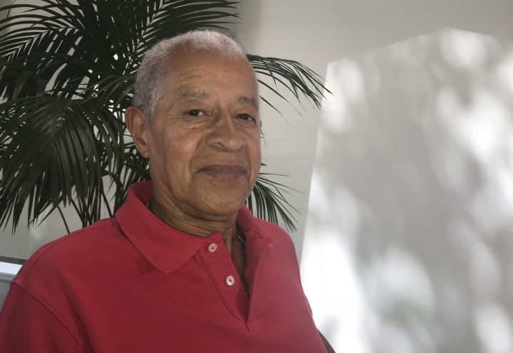 Herman Ouseley, chairman of English soccer anti-discrimination group entitled Kick It Out, poses for a photo after an interview with The Associated Press in London, Wednesday Aug. 8, 2018. (AP Photo/Rob Harris)