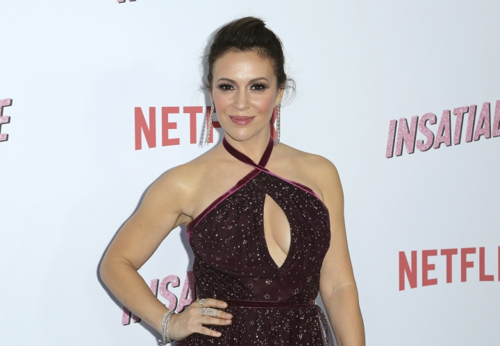 """Alyssa Milano arrives at the LA Premiere of """"Insatiable"""" at the Arclight Hollywood on Thursday, Aug. 9, 2018, in Los Angeles. (Photo by Willy Sanjuan/Invision/AP)"""