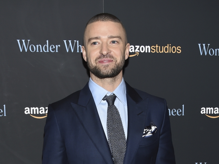 "FILE - In this Nov. 14, 2017 file photo, singer-actor Justin Timberlake attends a special screening of his film, ""Wonder Wheel"", in New York. Harper Design announced Friday, Aug. 10, that Timberlake has a book out this fall. ""Hindsight & All the Things I Can't See in Front of Me"" will feature images from his personal archives and ""anecdotes, reflections and observations."" The book comes out October 30. (Photo by Evan Agostini/Invision/AP, File)"