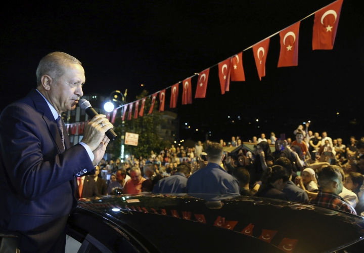 """Turkey's President Recep Tayyip Erdogan addresses supporters at his Black Sea hometown, Guneysu, Turkey, early Friday, Aug. 10, 2018. Turkey's Finance and Treasury Minister Berat Albayrak will reveal a """" new economic model """" as the Turkish Lira has lost more than 30 percent of its value since the start of the year.(Presidential Press Service via AP, Pool)"""