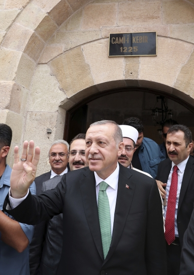 """Turkey's President Recep Tayyip Erdogan salutes supporters after Friday prayers, in Bayburt, Turkey, Friday, Aug. 10, 2018. Turkey's Finance and Treasury Minister, son-in-law of Erdogan, Berat Albayrak will reveal a """" new economic model """" as the Turkish Lira has lost more than 30 percent of its value since the start of the year.(Presidential Press Service via AP, Pool)"""