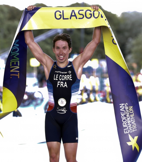 Pierre Le Corre of France crosses the finish line to take first place in the men's triathlon finals at Strathclyde Country Park during the European Championships in North Lanarkshire, Scotland, Friday, Aug. 10, 2018. (AP Photo/Darko Bandic)