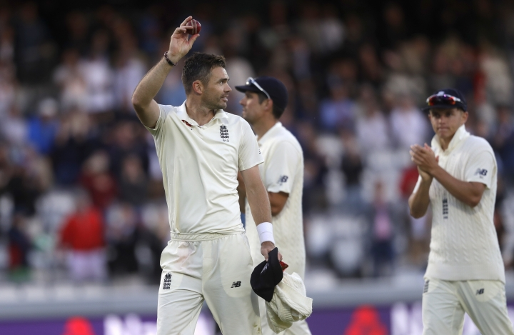 England's James Anderson holds up the ball to applause as he leaves the pitch after India are bowled out for 107 during the second day of the second test match between England and India at Lord's cricket ground in London, Friday, Aug. 10, 2018. (AP Photo/Kirsty Wigglesworth)