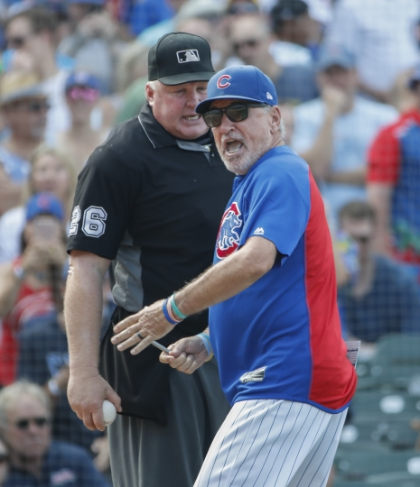 Chicago Cubs manager Joe Maddon, right, argues a call against his team with umpire Bill Miller, left, as he is ejected from a baseball game against the Washington Nationals during the seventh inning, Friday, Aug. 10, 2018, in Chicago. (AP Photo/Kamil Krzaczynski)