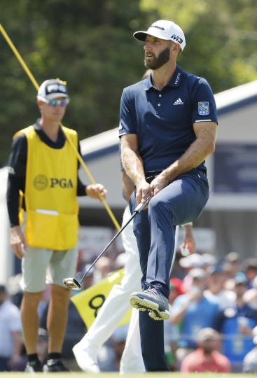 Dustin Johnson reacts to a missed putt on the eighth green during the second round of the PGA Championship golf tournament at Bellerive Country Club, Friday, Aug. 10, 2018, in St. Louis. (AP Photo/Jeff Roberson)