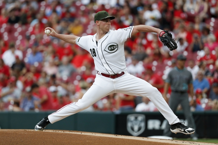Cincinnati Reds starting pitcher Anthony DeSclafani throws in the first inning of a baseball game against the Arizona Diamondbacks, Friday, Aug. 10, 2018, in Cincinnati. (AP Photo/John Minchillo)