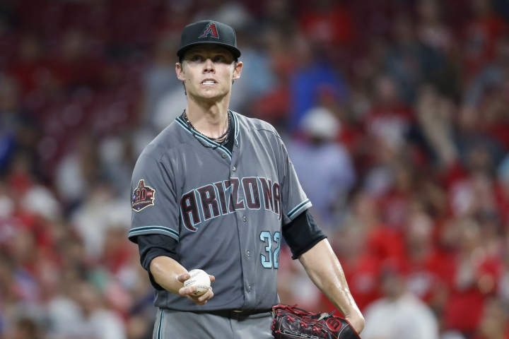 Arizona Diamondbacks starting pitcher Clay Buchholz reacts after giving up an RBI bunt single to Cincinnati Reds' Billy Hamilton during the seventh inning of a baseball game, Friday, Aug. 10, 2018, in Cincinnati. Another run scored on a throwing error by Buchholz, and Hamilton reached second. (AP Photo/John Minchillo)