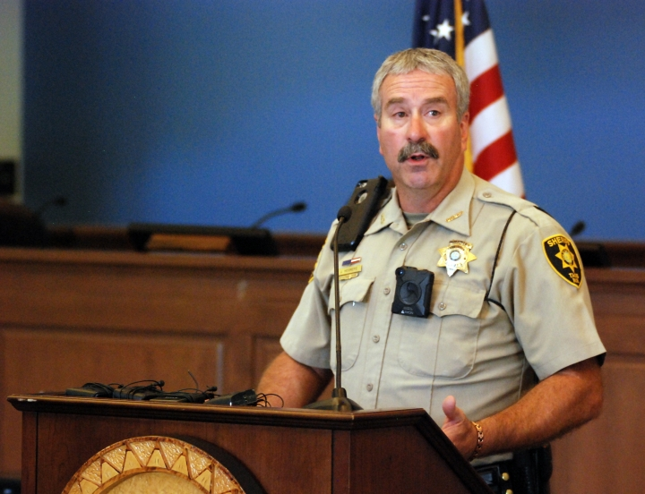 Taos County Sheriff Jerry Hogrefe announces at a news conference in Taos, N.M., on Tuesday, Aug. 7, 2018, that searchers have found the remains of a boy at the makeshift compound that was raided in search of a missing Georgia child. Hogrefe said authorities are awaiting a positive identification of the remains found Monday on the outskirts of Amalia, N.M. Authorities say the search for the child led them Friday to the squalid compound where they found his father, four other adults and 11 children living in filthy conditions. (AP Photo/Morgan Lee)