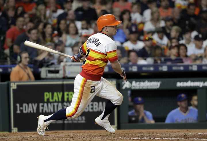 Houston Astros' Alex Bregman heads to first on an RBI double against the Seattle Mariners during the fifth inning of a baseball game Friday, Aug. 10, 2018, in Houston. (AP Photo/David J. Phillip)