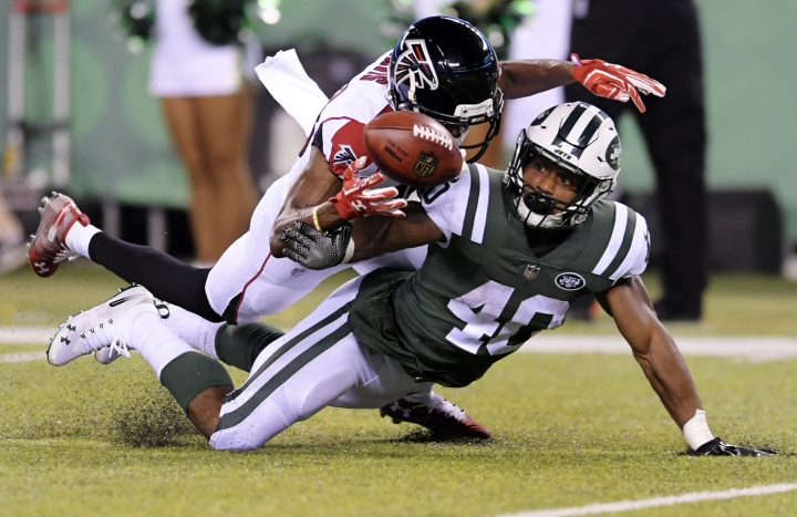 Atlanta Falcons wide receiver Reggie Davis defends against New York Jets' Trenton Cannon (40) during the second half of a preseason NFL football game Friday, Aug. 10, 2018, in East Rutherford, N.J. (AP Photo/Bill Kostroun)