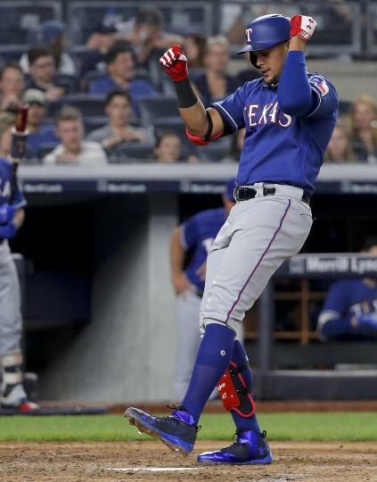 Texas Rangers' Ronald Guzman reacts as he crosses the plate after hitting a solo home run against the New York Yankees during the sixth inning of a baseball game Friday, Aug. 10, 2018, in New York. (AP Photo/Julie Jacobson)