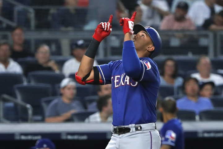 Texas Rangers' Ronald Guzman reacts as he crosses the plate after hitting a solo home run against the New York Yankees during the fourth inning of a baseball game Friday, Aug. 10, 2018, in New York. (AP Photo/Julie Jacobson)