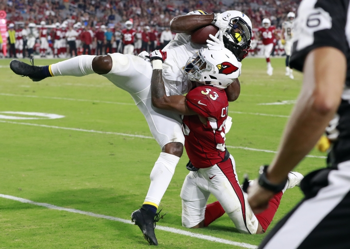 Los Angeles Chargers wide receiver Geremy Davis pulls in a touchdown pass as Arizona Cardinals defensive back Chris Campbell (33) defends during the second half of a preseason NFL football game, Saturday, Aug. 11, 2018, in Glendale, Ariz. (AP Photo/Rick Scuteri)