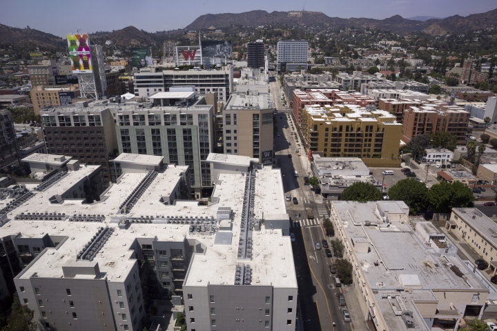 In this Monday, July 30, 2018, photo, several apartments line the streets as seen from the offices of the AIDS Healthcare Foundation in Los Angeles. The AIDS Healthcare Foundation and Alliance of Californians for Community Empowerment Action are sponsoring a measure known as Proposition 10. The measure would let cities and counties regulate rental fees in buildings current state law shields from such control. (AP Photo/Damian Dovarganes)