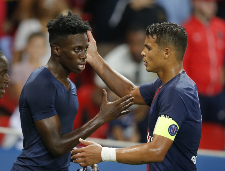 PSG's Thiago Silva, right, and PSG's Timothy Weah celebrate victory in their League One soccer match between Paris Saint-Germain and Caen at Parc des Princes stadium in Paris, Sunday, Aug. 12, 2018. (AP Photo/Michel Euler)