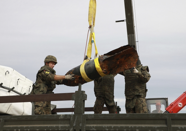 Navy experts in explosives are retrieving three World War II-era bombs from the Baltic Sea bed in the vacation resort of Kolobrzeg, Poland, on Monday, 13 August 2018. Some 2,200 people had to be evacuated to all allow for the removal of the bombs that were taken to a test range for controlled detonation.(AP Photo/Sekcja Prasowa 8.Flotylla Obrony Wybrzeża)