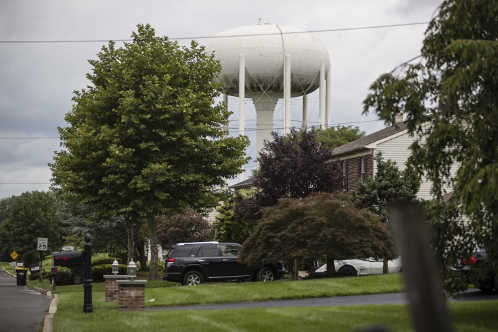 In this Aug. 1, 2018 photo, a water tower stands above a residential neighborhood in Horsham, Pa. In Horsham and surrounding towns in eastern Pennsylvania, and at other sites around the United States, the foams once used routinely in firefighting training at military bases contained per-and polyfluoroalkyl substances, or PFAS. EPA testing between 2013 and 2015 found significant amounts of PFAS in public water supplies in 33 U.S. states. (AP Photo/Matt Rourke)