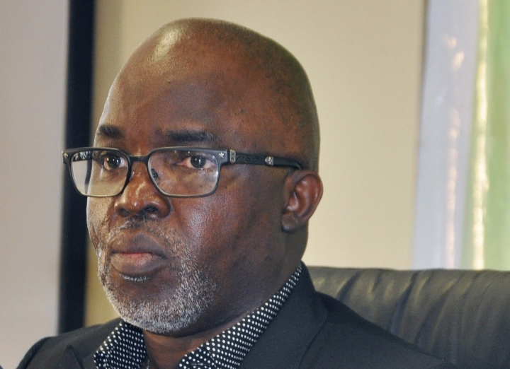 FILE - In this Wednesday, July 15, 2015 file photo, Nigeria Football Federation President Amaju Pinnick, speaks to the media at the National Stadium in Abuja, Nigeria, Wednesday, July 15, 2015. FIFA has given Nigeria and Ghana final deadlines to avoid international suspensions because of outside interference in their football associations. FIFA says the Nigerian Football Federation headquarters must be handed back to the elected leadership by Monday, Aug. 20, 2018 or the country will be suspended from international competition. (AP Photo/Olamikan Gbemiga, File)