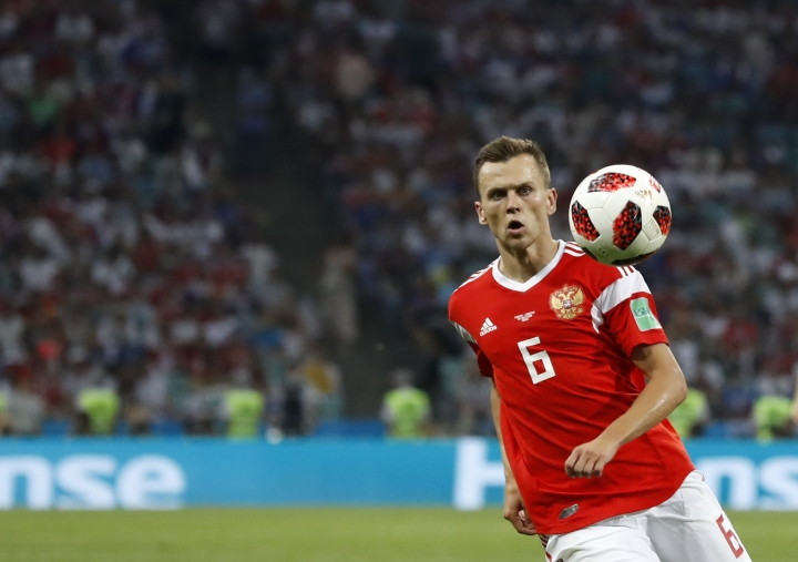 """FILE - In this Saturday, July 7, 2018 file photo, Russia's Denis Cheryshev controls the ball during their quarterfinal match against Croatia at the 2018 soccer World Cup in the Fisht Stadium, in Sochi, Russia. Valencia says it has reached an agreement with Villarreal for the loan of Russia forward Denis Cheryshev. The club said Tuesday, Aug, 14 the loan is """"pending formalization"""" and will be valid until the end of the season. (AP Photo/Rebecca Blackwell, file)"""