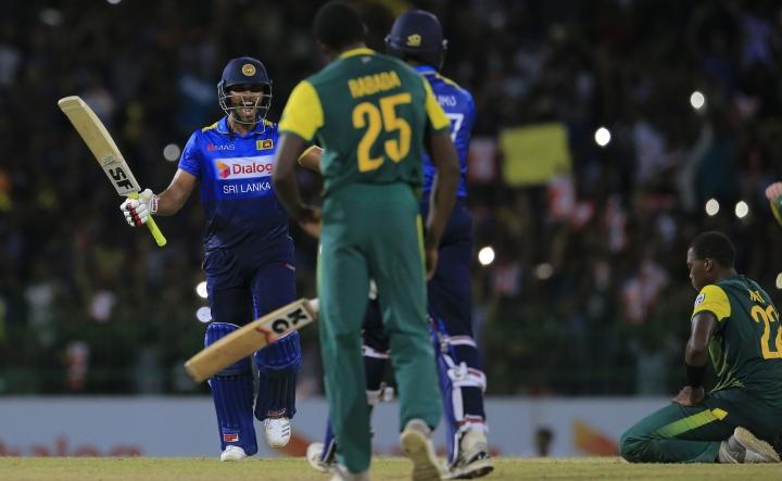 Sri Lanka's Dinesh Chandimal, left, and Isuru Udana celebrate their team's victory over South Africa by three wickets in their Twenty20 cricket match in Colombo, Sri Lanka, Tuesday, Aug. 14, 2018. (AP Photo/Eranga Jayawardena)
