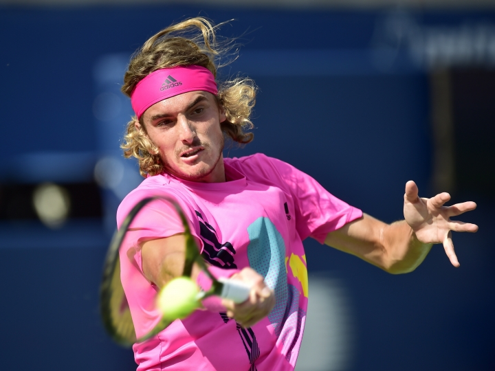 Stefanos Tsitsipas of Greece returns to Rafael Nadal of Spain during championships men's finals Rogers Cup tennis action in Toronto on Sunday, Aug. 12, 2018 in Montreal. (Frank Gunn/The Canadian Press via AP)