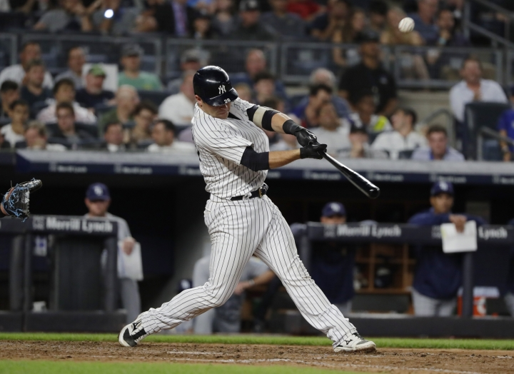 New York Yankees' Austin Romine hits a two-run home run during the fifth inning of a baseball game against the Tampa Bay Rays Tuesday, Aug. 14, 2018, in New York. (AP Photo/Frank Franklin II)