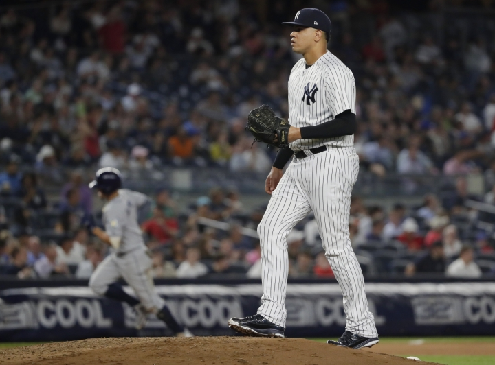 New York Yankees relief pitcher Dellin Betances reacts as Tampa Bay Rays' Willy Adames runs the bases after hitting a home run during the eighth inning of a baseball game against the New York Yankees Tuesday, Aug. 14, 2018, in New York. (AP Photo/Frank Franklin II)