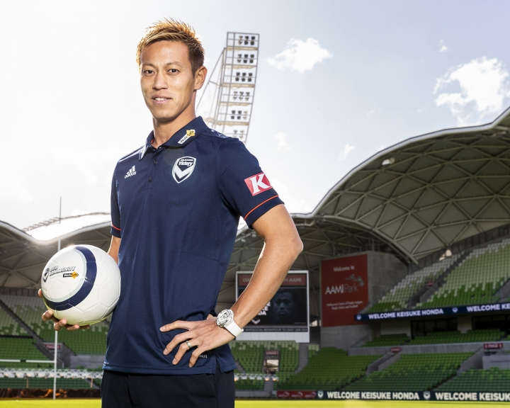 Japan star Keisuke Honda poses for a photo in Melbourne, Wednesday, Aug. 15, 2018, after signing with the Melbourne Victory in Australian soccer's A-League. Already retired from international soccer, 32-year-old Honda said he intended to end his playing career before coach Kevin Muscat lured him to the Victory on a one-year contract worth a reported $2.9 million. (Daniel Pockett/AAP Image via AP)