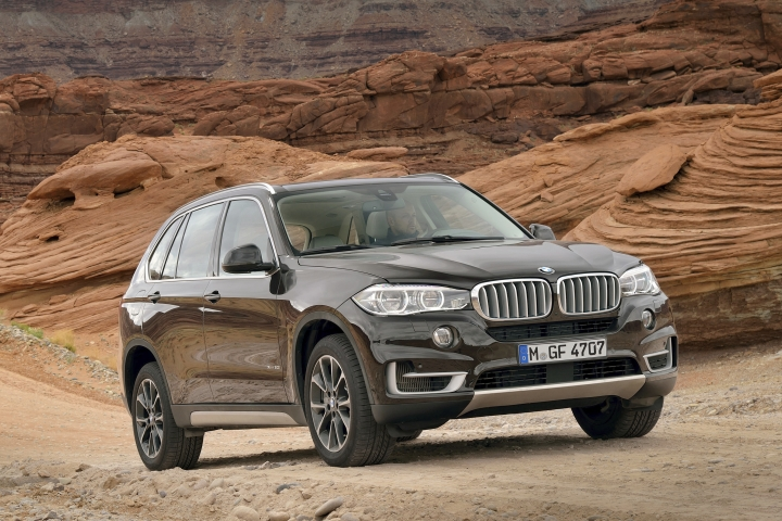 This undated photo provided by BMW shows the 2014 X5. The midsize X5 really set the standard for the current crop of road-focused luxury SUVs, blending refinement and performance with utility and technology. A variety of engines areis available, including a high-torque diesel. (Courtesy of BMW of North America via AP)