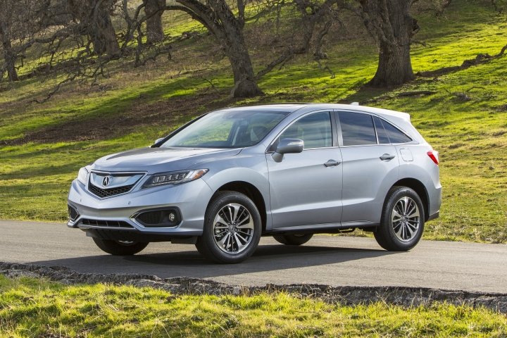 This photo provided by Honda shows the Acura 2016 RDX. Thanks to its strong V6 engine, sporty handling, a long list of tech features, and a good amount of cargo space, the Acura RDX is an appealing compact luxury SUV. Slightly older models are still a good bet, but Acura improved the RDX's infotainment interface for 2016 and added a handful of active safety features and extra standard equipment. (Wieck/Courtesy of American Honda Motor Co. via AP)