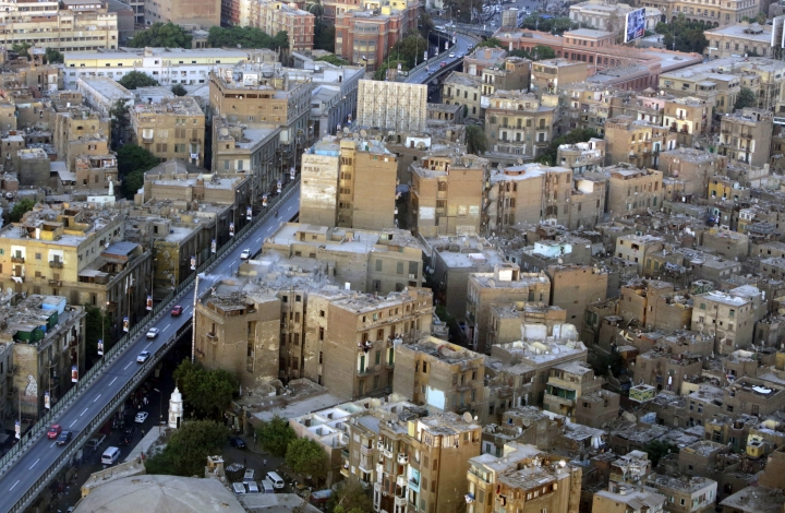 This July 18, 2014 photo, shows buildings, to the right of the bridge, that are to be demolished as part of a redevelopment plan in the Maspero neighborhood of Cairo, Egypt. Egyptian authorities are demolishing the historical 19th century neighborhood in Cairo to make way for high-end housing and business development a stone's throw from the Nile, angering residents who say they have not been properly compensated. The neighborhood is named for French Egyptologist Gaston Maspero who helped found the Egyptian Museum. (AP Photo/Amr Nabil)
