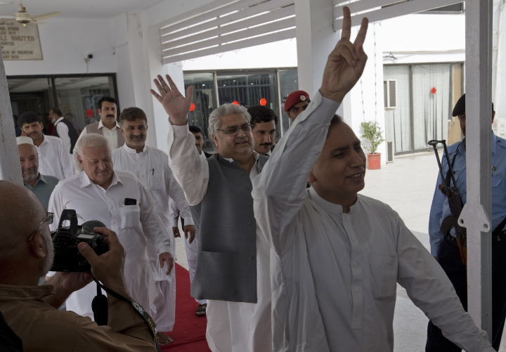 Parliamentarians of Pakistan Tahreek-e-Insaf party headed by Imran Khan, celebrate the victory of their candidate at the National Assembly in Islamabad, Pakistan, Wednesday, Aug. 15, 2018. Pakistan's lower house of parliament elected an ally of Imran Khan to be its next speaker on Wednesday, paving the way for the former cricket star and longtime politician to become the next prime minister. (AP Photo/B.K. Bangash)