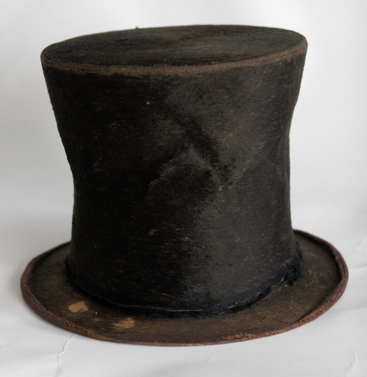 FILE - In this June 14, 2007 file photo, Abraham Lincoln's iconic stovepipe hat is photographed at the Abraham Lincoln Presidential Library and Museum in Springfield, Ill. The hunt for auctioneers to sell off valuable Lincoln artifacts to pay a $9.7 million debt began Wednesday, Aug. 15, 2018 but the Abraham Lincoln Presidential Library and Museum Foundation cautioned a sale isn't imminent. The foundation voted in a private meeting to begin seeking an auction house to dispose parts of the Taper collection of 1,400 items related to Lincoln. (AP Photo/Seth Perlman File)