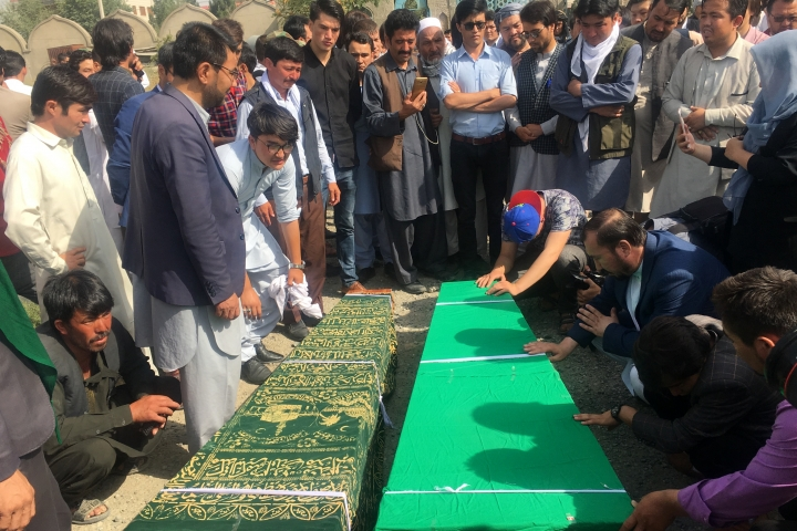 Relatives pray near to the dead bodies of civilians after Wednesday's deadly suicide bombing that targeted a training class in a private building in the Shiite neighborhood of Dasht-i Barcha, in western Kabul, Afghanistan, Thursday, Aug. 16, 2018. (AP Photo/Rahmat Gul)