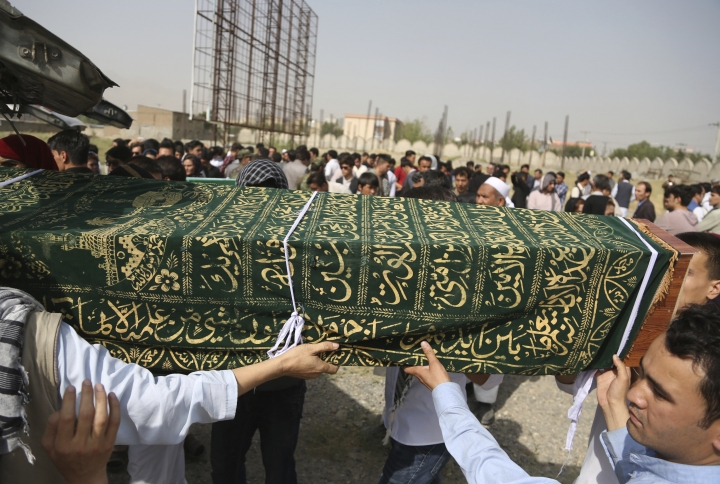 Men carry the coffin of a relative who died in Wednesday's deadly suicide bombing that targeted a training class in a private building in the Shiite neighborhood of Dasht-i Barcha, in western Kabul, Afghanistan, Thursday, Aug. 16, 2018. The Afghan authorities have revised the death toll from the previous day's horrific suicide bombing in a Shiite area of Kabul to 34 killed. (AP Photo/Rahmat Gul)