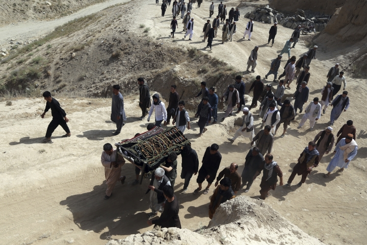 Men carry the coffin of a relative who died in Wednesday's deadly suicide bombing that targeted a training class in a private building in the Shiite neighborhood of Dasht-i Barcha, in western Kabul, Afghanistan, Thursday, Aug. 16, 2018. The Afghan authorities have revised the death toll from the previous day's horrific suicide bombing in a Shite area of Kabul to 34 killed. (AP Photo/Rahmat Gul)