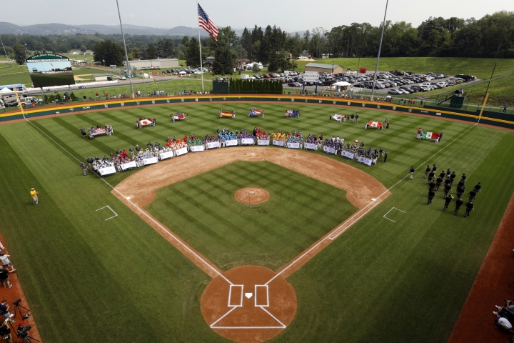 The 16 Little League teams competing in the 2018 Little League World Series baseball tournament line the field at Volunteer Stadium during the opening ceremony in South Williamsport, Pa., Thursday, Aug. 16, 2018. (AP Photo/Gene J. Puskar)