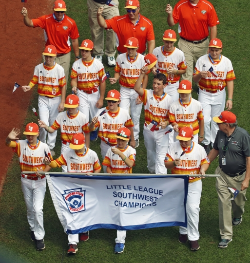 The Southwest Region Champion Little League team from Houston, Texas, participates in the opening ceremony of the 2018 Little League World Series baseball tournament in South Williamsport, Pa., Thursday, Aug. 16, 2018,. (AP Photo/Gene J. Puskar)